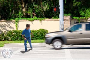 Jaywalking man about to be run over by a truck
